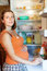 Woman looking for something in refrigerator