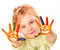 Portrait of a happy cheerful girl showing her hands painted in bright colors