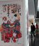 Visitors are looking China's traditional New Year paintings on a exhibition in the National Library of China