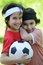 Young boys holding football