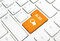 Blog business concept, text and icon. Orange button or key on white keyboard