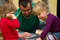 Father playing toy blocks with children