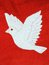 White dove on red fabric.