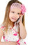 Happy little girl speaking by cell phone isolated