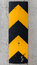 Vertical caution striped yellow and black sign