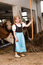 Girl in a cow stable