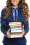 Closeup on business woman with stack of books