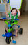 Cute Baby riding a tricycle