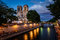 Notre Dame de Paris Cathedral and Seine River in the Evening
