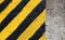 Black and yellow striped caution sign