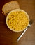 Mac and cheese with whole grain bread on wood background