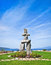 Inukshuk, symbol of the 2010 winter olympic games, with blue sky at English Bay in Vancouver, British Columbia, Canada
