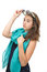 Beautiful teen girl with sunglasses and blue scarf around her neck posing