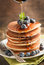 Stack of pancakes with blueberry and maple syrup
