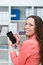 Smiling businesswoman texting on her smartphone