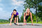 Sports outdoor - young women doing fitness in park