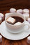 White mugs with hot chocolate and marshmallows