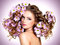 Young beautiful woman with flowers in hairs