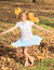 Girl with maple leaves dancing