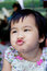 Close up face of lovely and cute asian baby making funny mouth