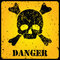 Yellow danger sign with skull