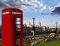 Big Ben with red phone booth in London, England