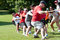 Adults Pull Rope In Team Tug-Of-War Competition