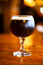 Glass of dark Belgian beer.
