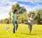 Family together playing with soccer ball