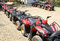Quad bikes atv in row