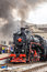 Old steam train is leaving a station