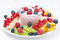 Assorted fresh fruit and berries and fruit yogurt