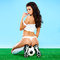 Seductive female soccer player in an erotic pose