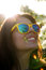 Smiling woman in fashionable sunglasses