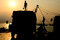 Silhouette of man on truck with sunset sky