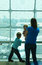 Mother with kids waiting in the airport