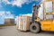 Forklift truck transporting wood cargo box