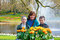 Happy family with yellow tulips.
