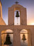 Church Bell Tower at Sunset in Santorini, Greece