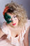 Beautiful young woman in a green mysterious venetian mask a new year carnival, Christmas masquerade, a dance club, secret nigh