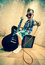 Cool little boy posing with electric guitar.
