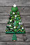 Green christmas decoration with wood: tree of balls on grey back