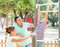 Happy couple with teenage son training on pull-up bar