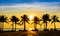 Fantastic tropical beach with palms at sunset