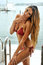 Beautiful long hair tanned female model posing on the luxury yacht