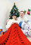 Happy couple under christmas tree with knitting work