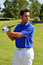 Male Golfer Poses With Golf Club