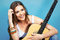 Happy musician woman portrait with guitar