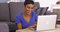Happy black woman surfing the internet