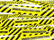 Yellow warning caution ribbon tape on white